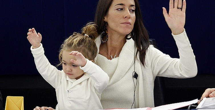 Licia Ronzulli takes part with her daughter Victoria in a voting session at the European Parliament in Strasbourg-1394464