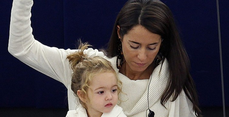 Licia Ronzulli takes part with her daughter Victoria in a voting session at the European Parliament in Strasbourg-1394465